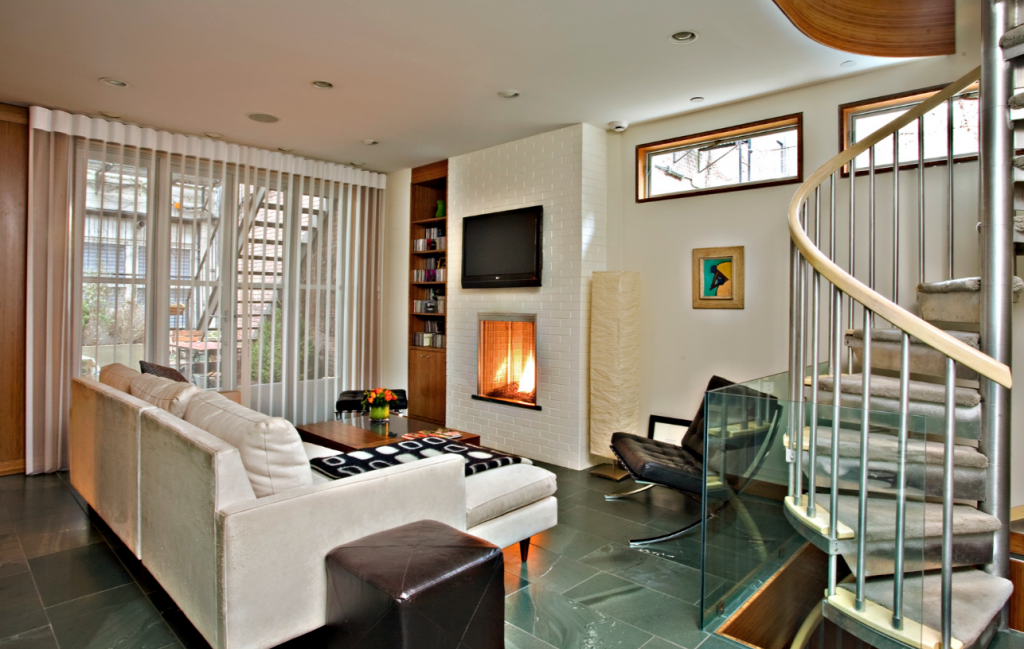 The living room opens onto the home's secret garden in back.